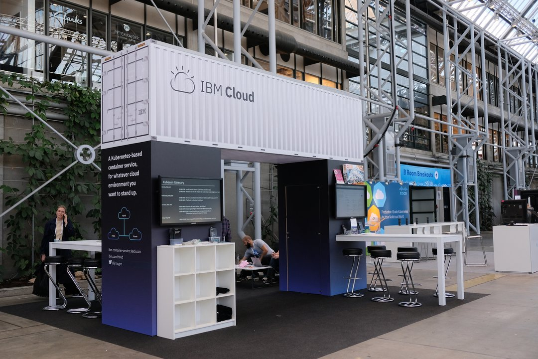 An empty shipping container probably made of cardboard hanging over the IBM booth
